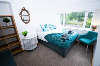 Ideal Home away at Brecon - Relax in this comfortable double bedroom.