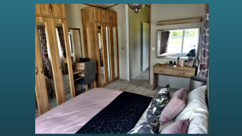The master bedroom with its extensive wardrobe space, grand dressing area tucked around the corner and beautiful en-suite shower room