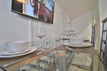 Homely Spaces - ...with place settings for four.