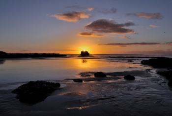 Sunrise over Black Rock at Millendreath Beach