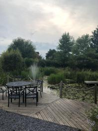 The beautiful gardens and pond at Slades Farm