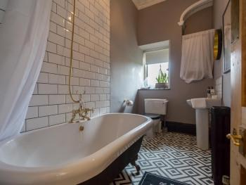 Stylish bathroom with roll top bath