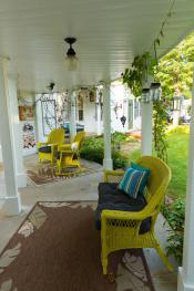 Linda's favorite porch for early morning coffee and conversing with hummingbirds.  Taken from the entrance door of suite 1.