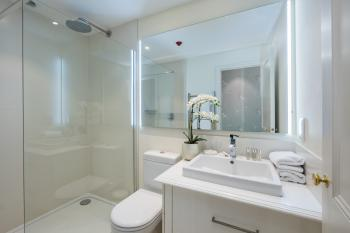 Ensuite shower room with rainfall shower head.