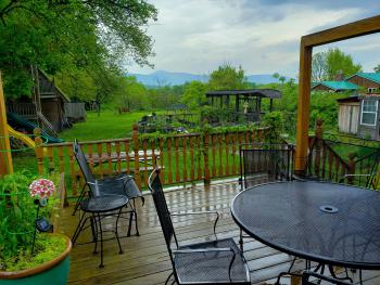 deck and koi pond in spacious back yard ideal country setting for relaxation and rejuvination