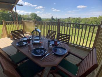 Large raised deck with dining table