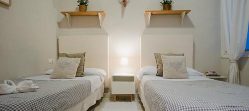 Doble con 2 camas