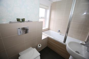 Room 6 en suite - shower and bath