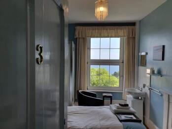 Single, en-suite private toilet, seaview