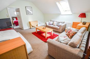 Cheshire Sanctuary - Open plan living / sleeping area (2 singles and 2 sofa beds)