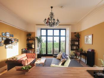 Large light sitting room with original wooden shutters