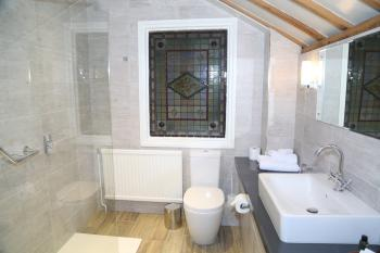 En-suite shower room in the upper station house room
