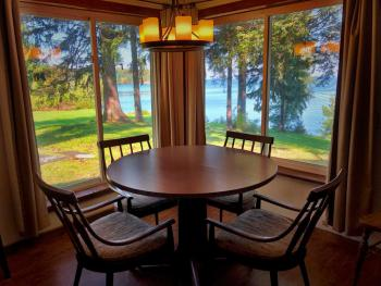 Close up dinning room with great views.  Table has leaves and expands.