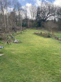 Fully enclosed back garden at Maple Bank