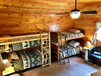 The BUNK room has 1 Twin and 2 bunks and extra TV