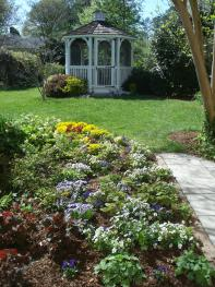 Back flower garden with gazebo
