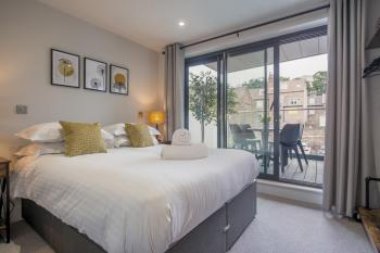 Bedroom one, leading onto balcony with views of the Minster.