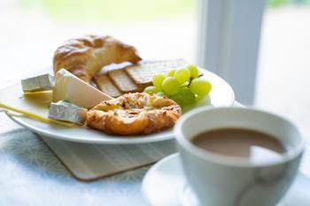 Breakfast - Fresh pastries alongside a selection of cheese and crackers