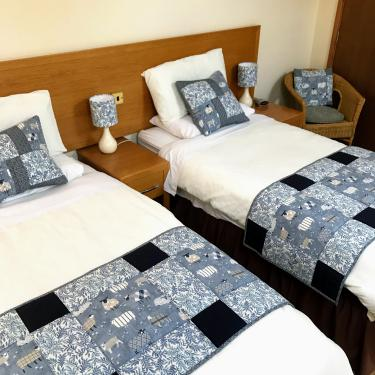 Room one set with twin beds