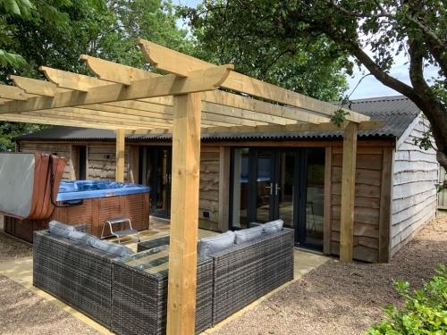 outdoor entertainment area & hot tub