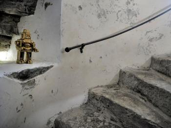 Gold robot guards the original stone spiral staircase