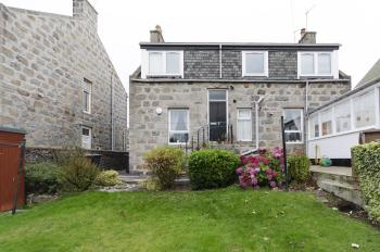 City Apartment with Rural Charm - Rear of property and visible private front door, private stairs immediately on entry lead to accommodation