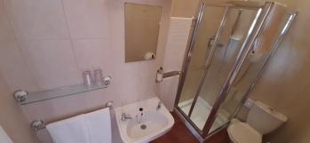 Large Super King Ensuite with Sofa & Fridge Shower Room
