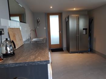 Utility Room with large Fridge/Freezer