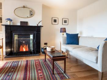 Sitting room with open fire to relax