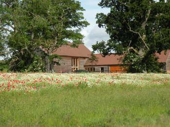 South Park Farm Barn - South Park Farm Barn seen from across its wildflower meadow