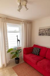 TV Room with Comfy Sofa (gives extra space to socialise!)