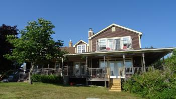 A view of the house with verandah & upstairs balcony