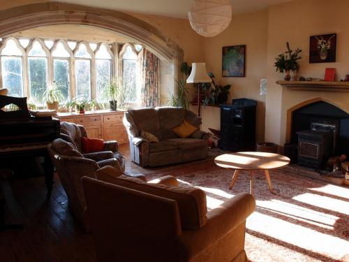 Sitting Room with Wood-burning Stove and Piano