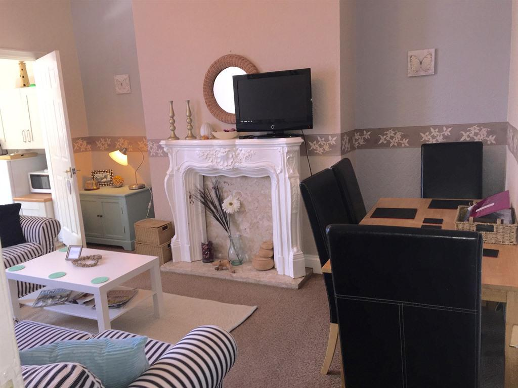 Living room with seating for 5 (dining table seats 4)