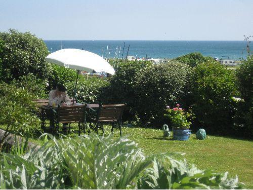 Relaxing in the garden which overlooks the beach