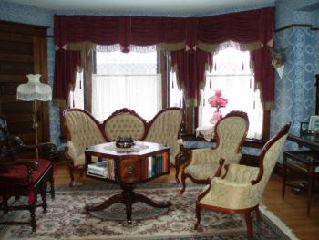 Middle parlor sometimes referred to in Victorian days as the men's parlor.  Ladies can sit here too. :)