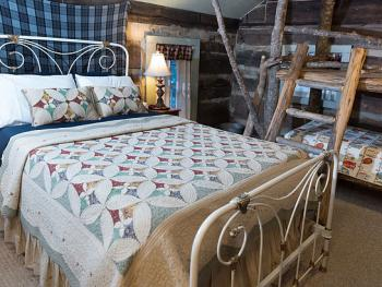 The Daniel Boone room features unique decor and furnishings, including a kid-friendly bunk bed.