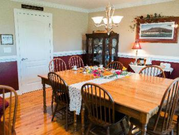 Dining Room at A Mighty Oak B&B with Fresh Flowers and meals prepared from ingredients from the farm or local foods.  Most of the time we use Organic or Non-GMO ingredients