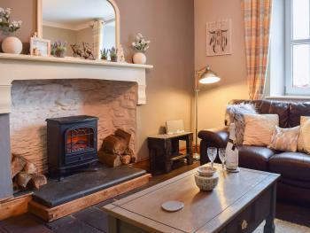 The cosy lounge is in the heart of the house, with a large window overlooking the Teifi Valley.