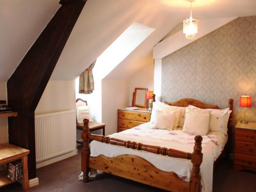 3rd floor Attic double en-suite. Tall room with memory foam bed, flat screen TV, free films, freeview. Rear facing