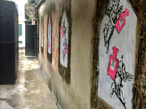 view of private alley with street art