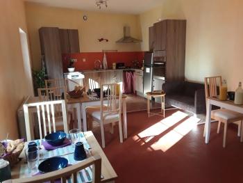 Les Coûtas - espace détente et cuisine commune