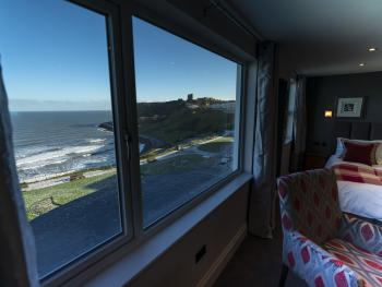 Sit back and enjoy the view from large picture window in The Sea View Penhouse Suite