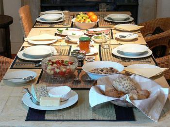 A generous continental breakfast with fresh local ingredients