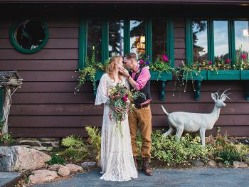 Wedding couple outside of Dailey Cabin. We love hosting elopement ceremonies and intimate weddings.