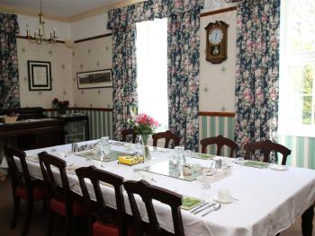 Guest dining room with large antique dining table