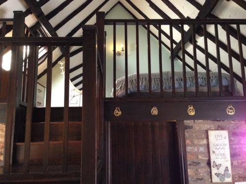 Mezzanine bedroom at Blacksmiths Cottage