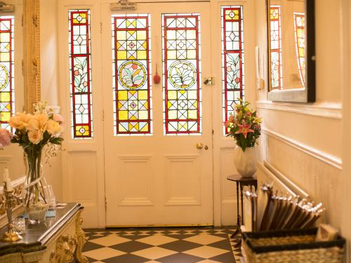 Entrance hall with stained glass front doors