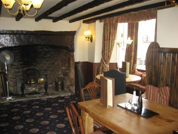 Front bar with inglenook open fire place a great place for a drink and bar meals