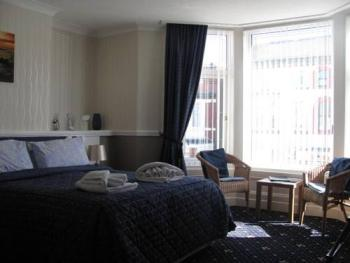 Room 5 One of our really spacious family/double rooms,ensuite shower ,tea/coffee, freeview tv large south facing bay window.